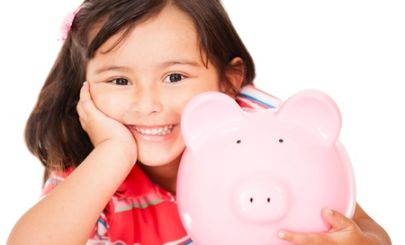 little-asian-girl-holding-piggybank
