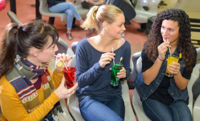 three-young-women-drinking-cordial